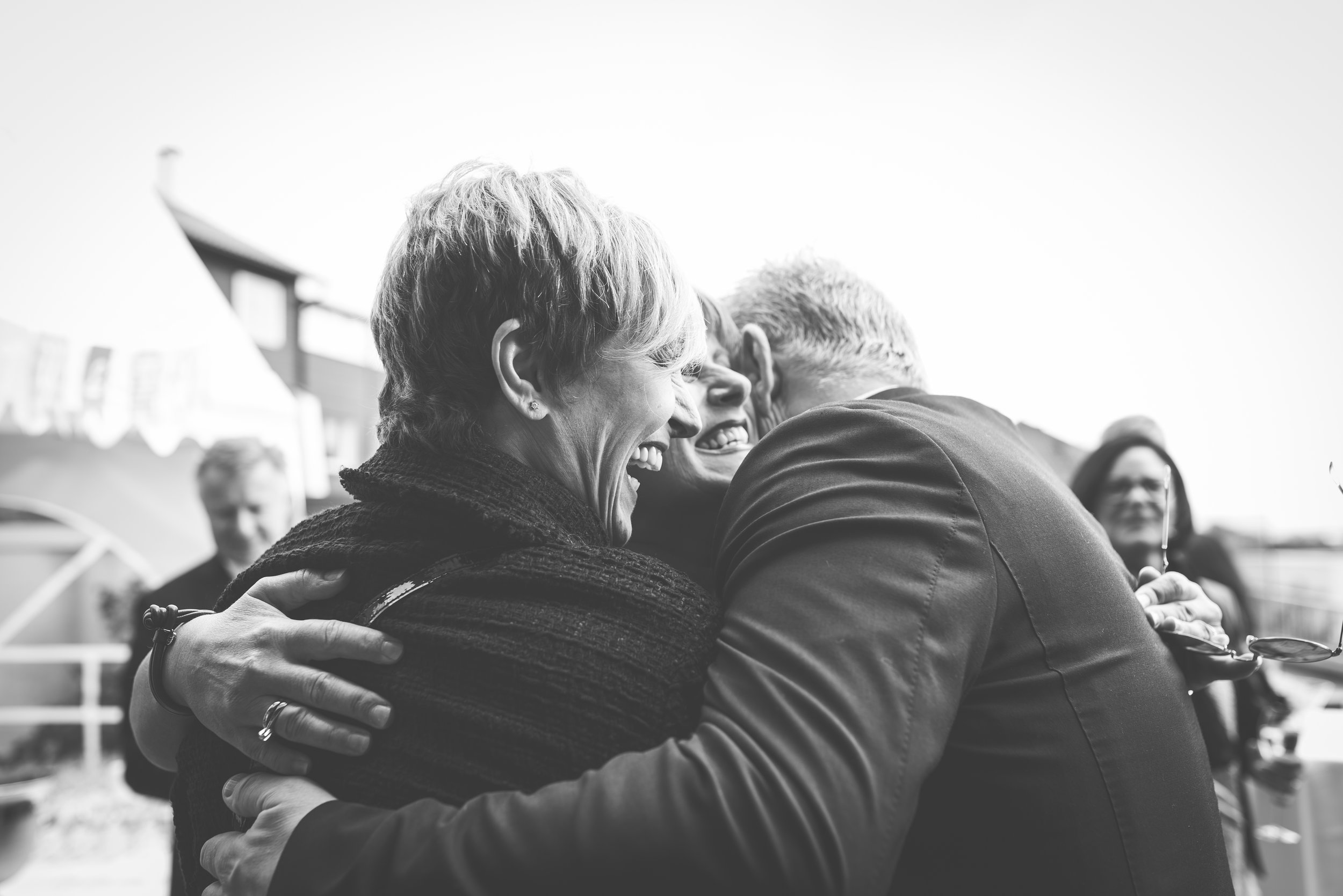 People hug at the wedding reception BW Stavanger Guillem Cheung Bryllup