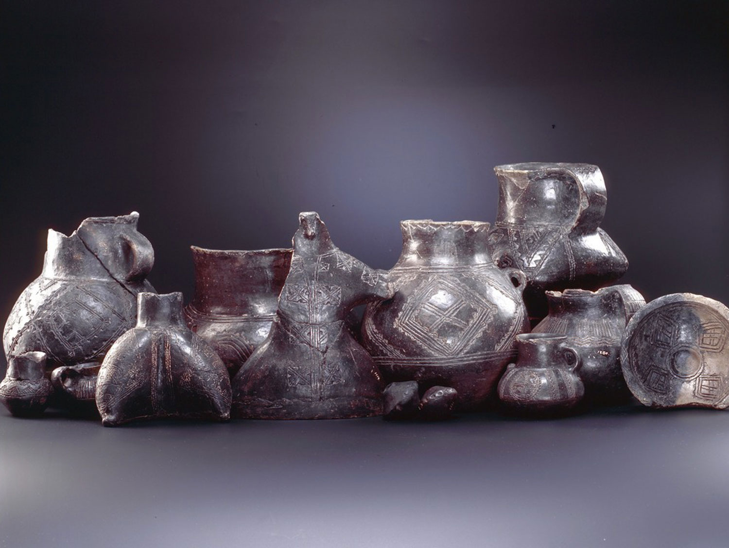prehistoric urns with decoration made with thread