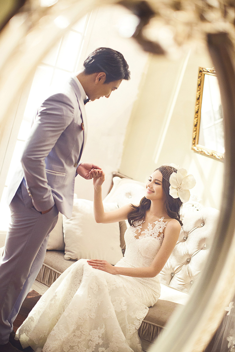 Light grey suit on handsome groom with his bride