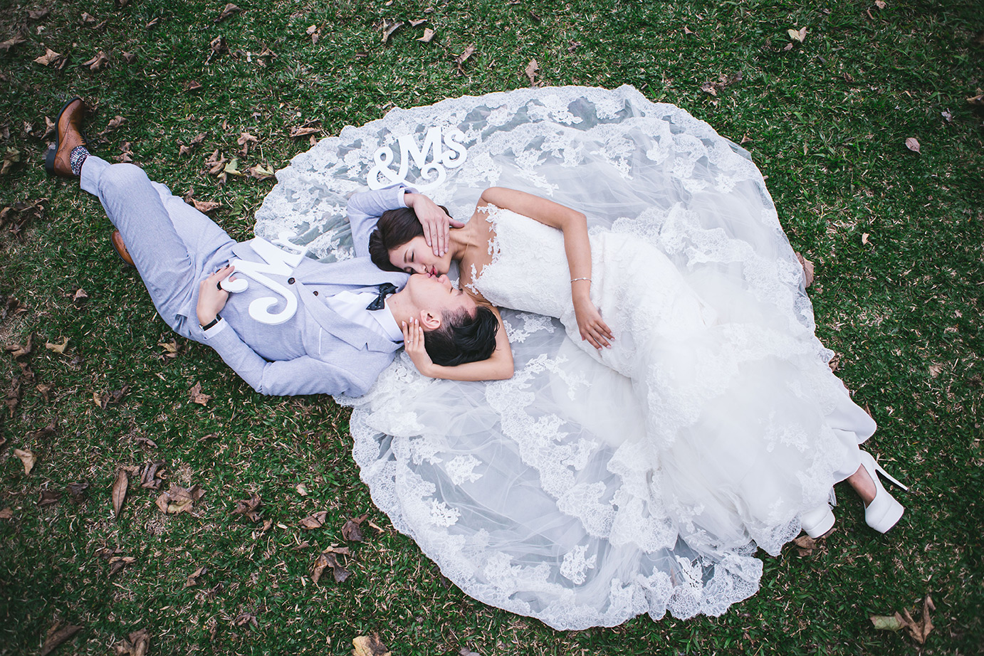 Grey suit laying with bride
