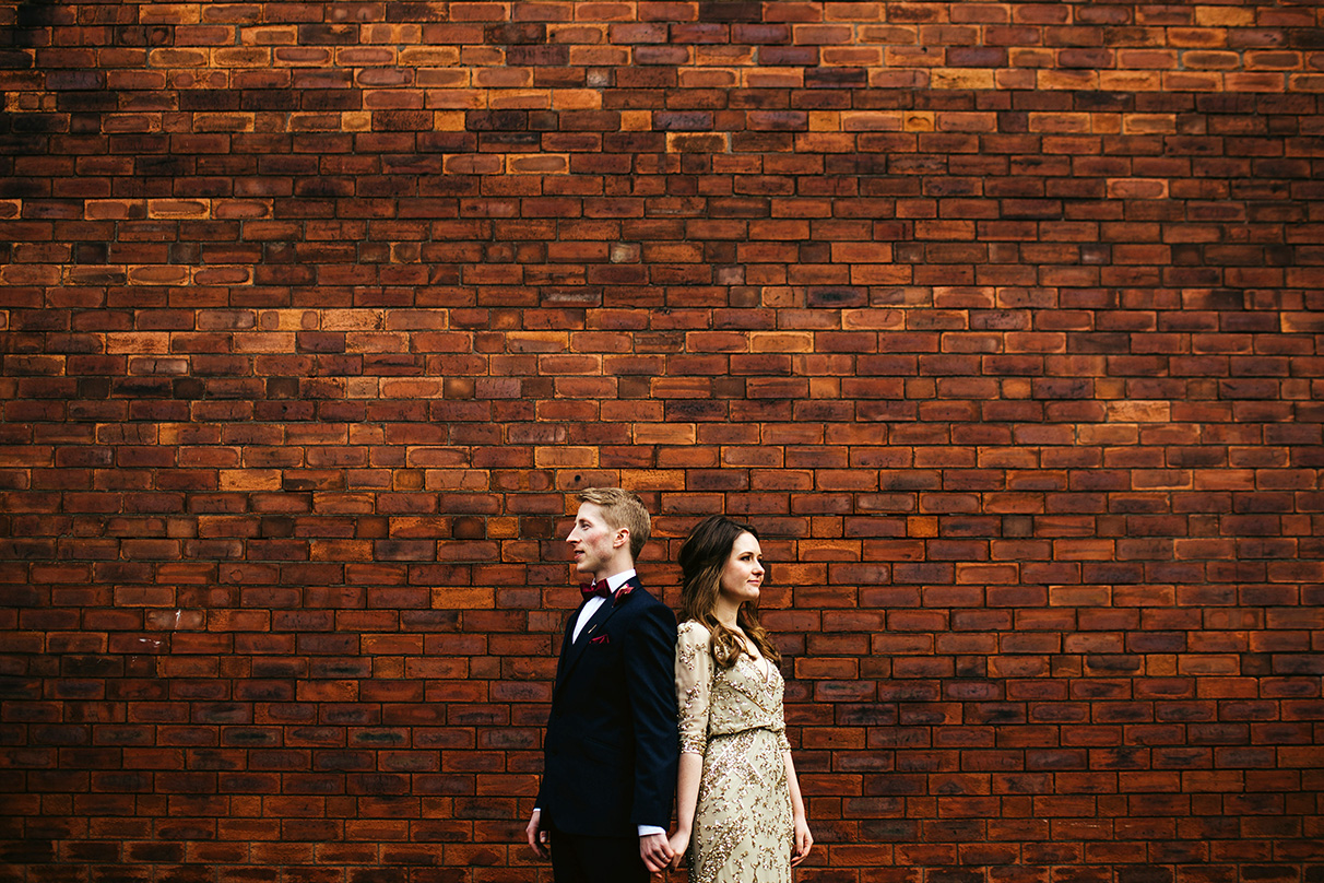 Cool couple in front of a super cool wall