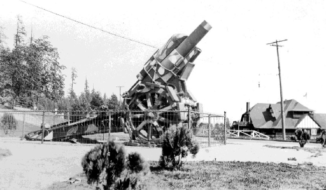 Captured Mörser 16, a 21cm German heavy howitzer captured by the 72nd Battalion, Seaforth Highlanders of Canada at the entrance to Stanley Park. The Vancouver Rowing Club is visible in the background.