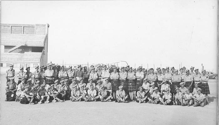 Officers, NCOs, and men of the Imperial Seaforth Highlanders and the Canadian Seaforth at Catania, Sicily.