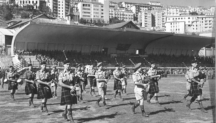 Seaforth Highlanders Pipes and Drums playing in the Stadio Alfredo Viviani (opened 1934) in Potenza (Basilicata), Italy 1943.