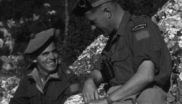 Lieutenant-Colonel B.M. Hoffmeister, commander of the Seaforth Highlanders of Canada, talks to one of his staff officers in Sicily, August 1943.