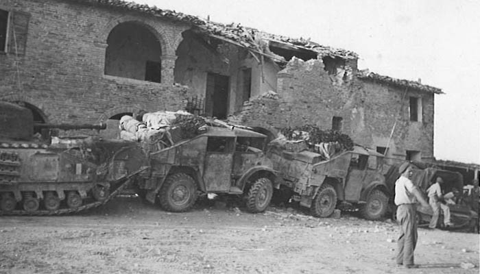 "Possibly the same location as the photo of the church HQ. The truck type remains unidentified. On rear: ""Sicily - Italy 1943?"""