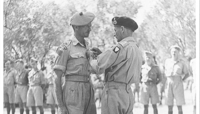 "Major H.P. Bell-Irving receiving the Distinguished Service Order (DSO) from General Sir Bernard Montgomery, GOC 8th Army for his actions with A Company at ""Grizzly Hill"" near Agira."