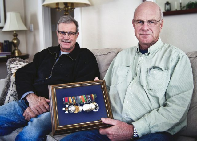 Patrick Vicars (left) and brother Tom showcase their fathers many military medals, including the Distinguished Service Order (left). The brothers will be at a memorial in Vimy Ridge this weekend to mark its 100th anniversary. Jessica Wallace/KTW
