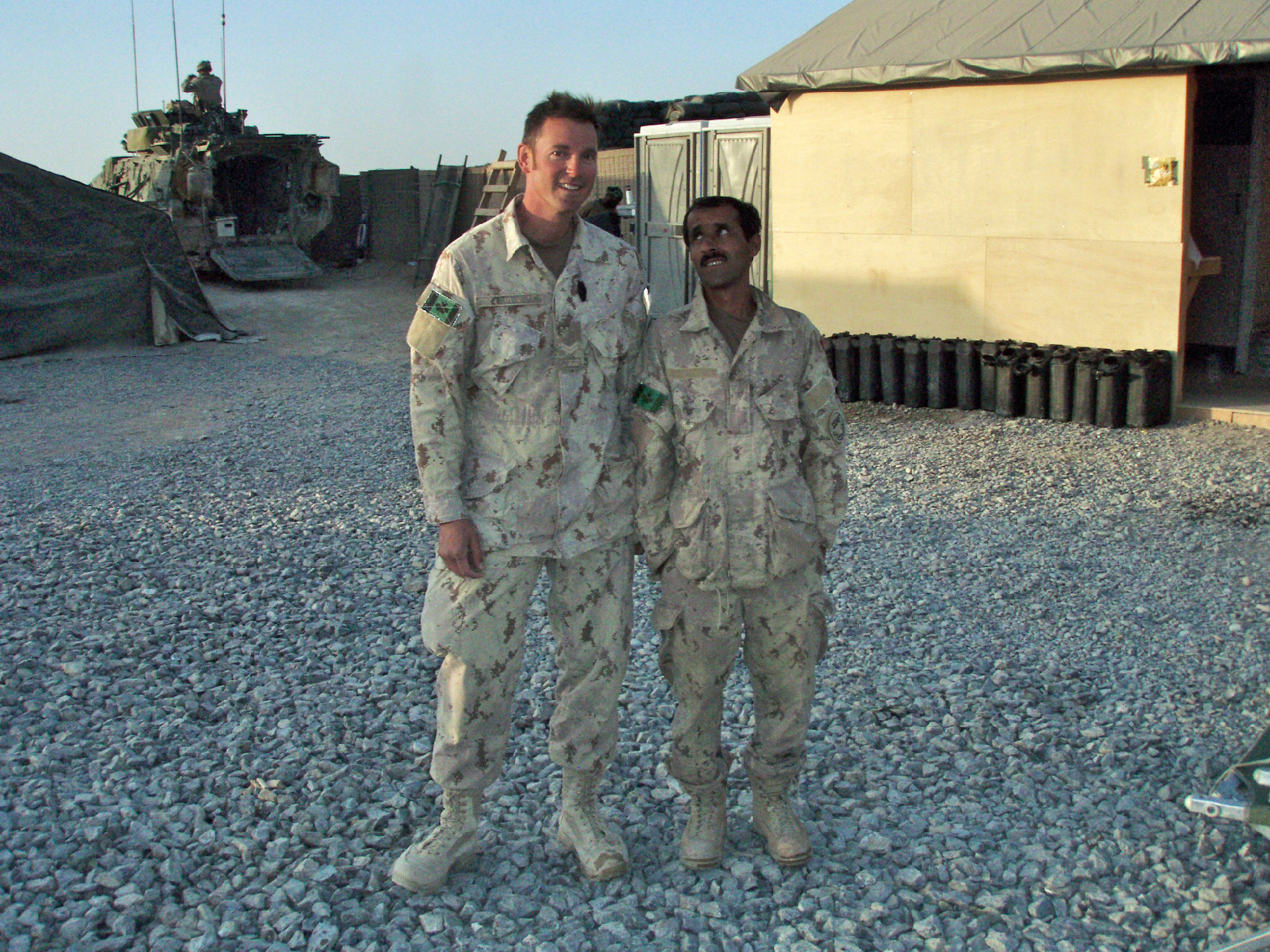"""Corporal Muir says farewell to """"Abdullah"""" – the most reliable and competent interpreter he ever worked with – upon the Canadian's departure from Combat Outpost Walakan for the last time after handing it over to the Americans, April 2010."""