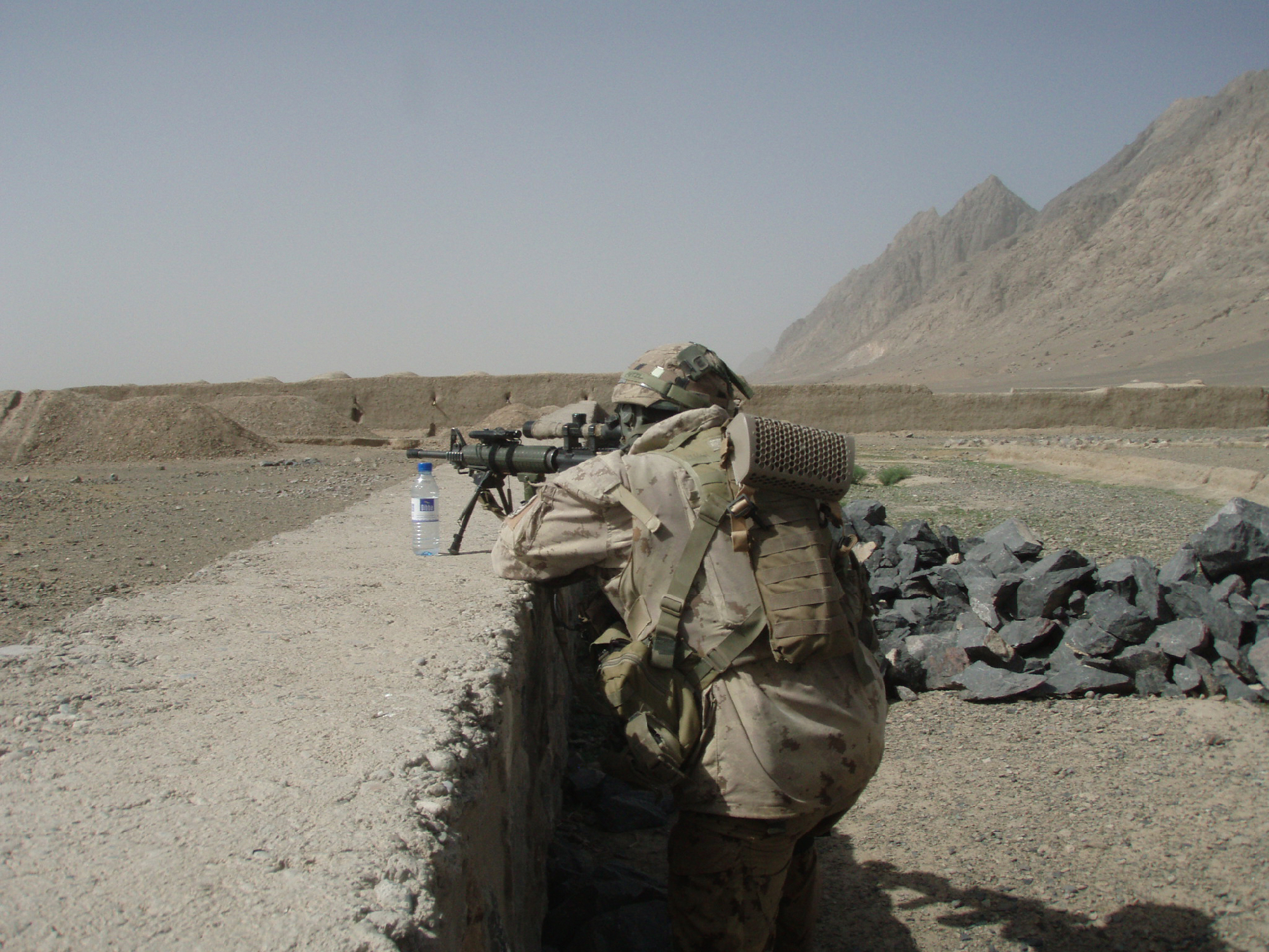 A Seaforth provides 'top cover' for a patrol outside the village of Dah-e-Bagh, Dand district. April 2010