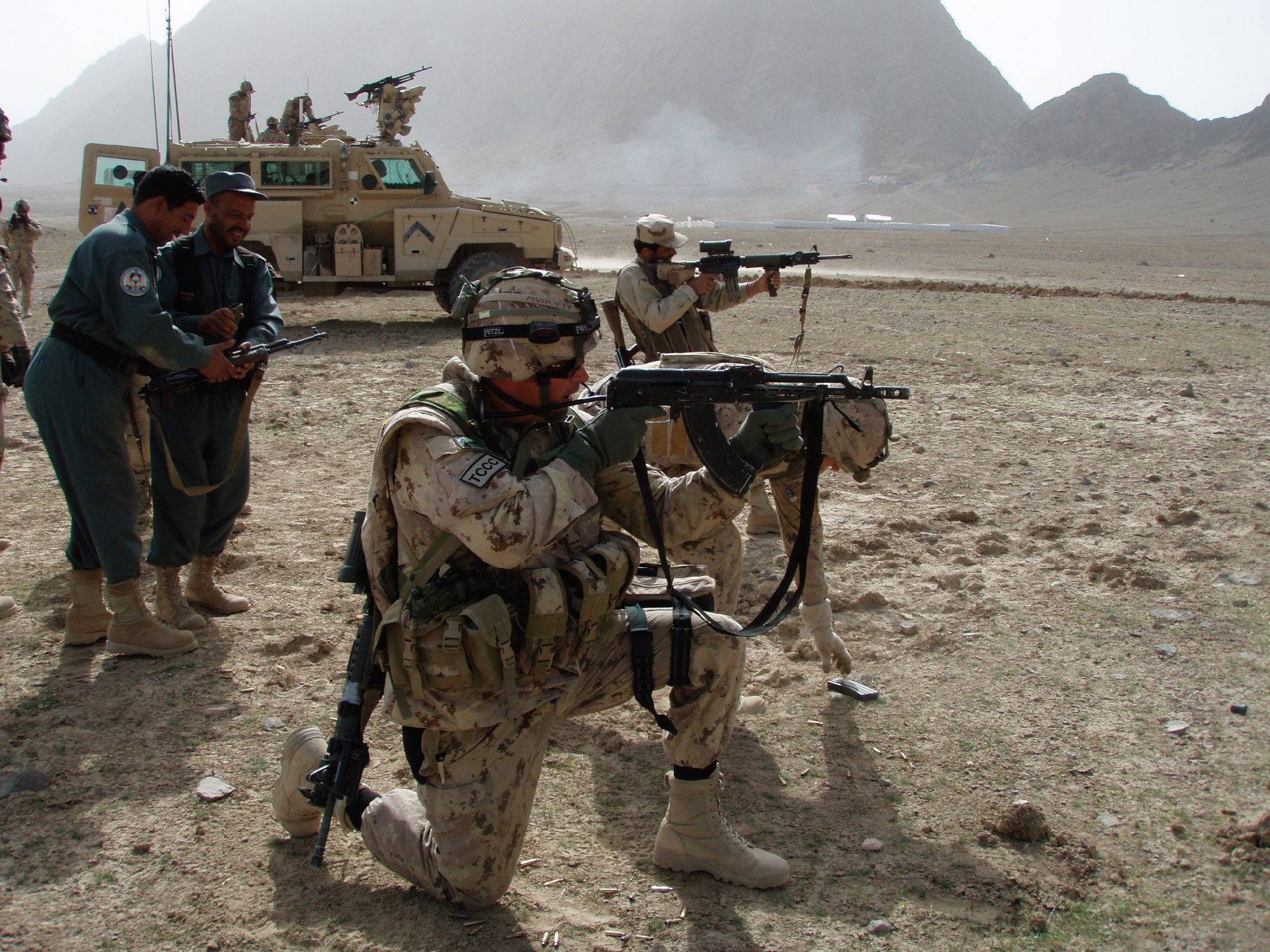 Training shoot with vehicles, our weapons and Afghan National Police weapons, desert north of Kandahar city, March 2008.