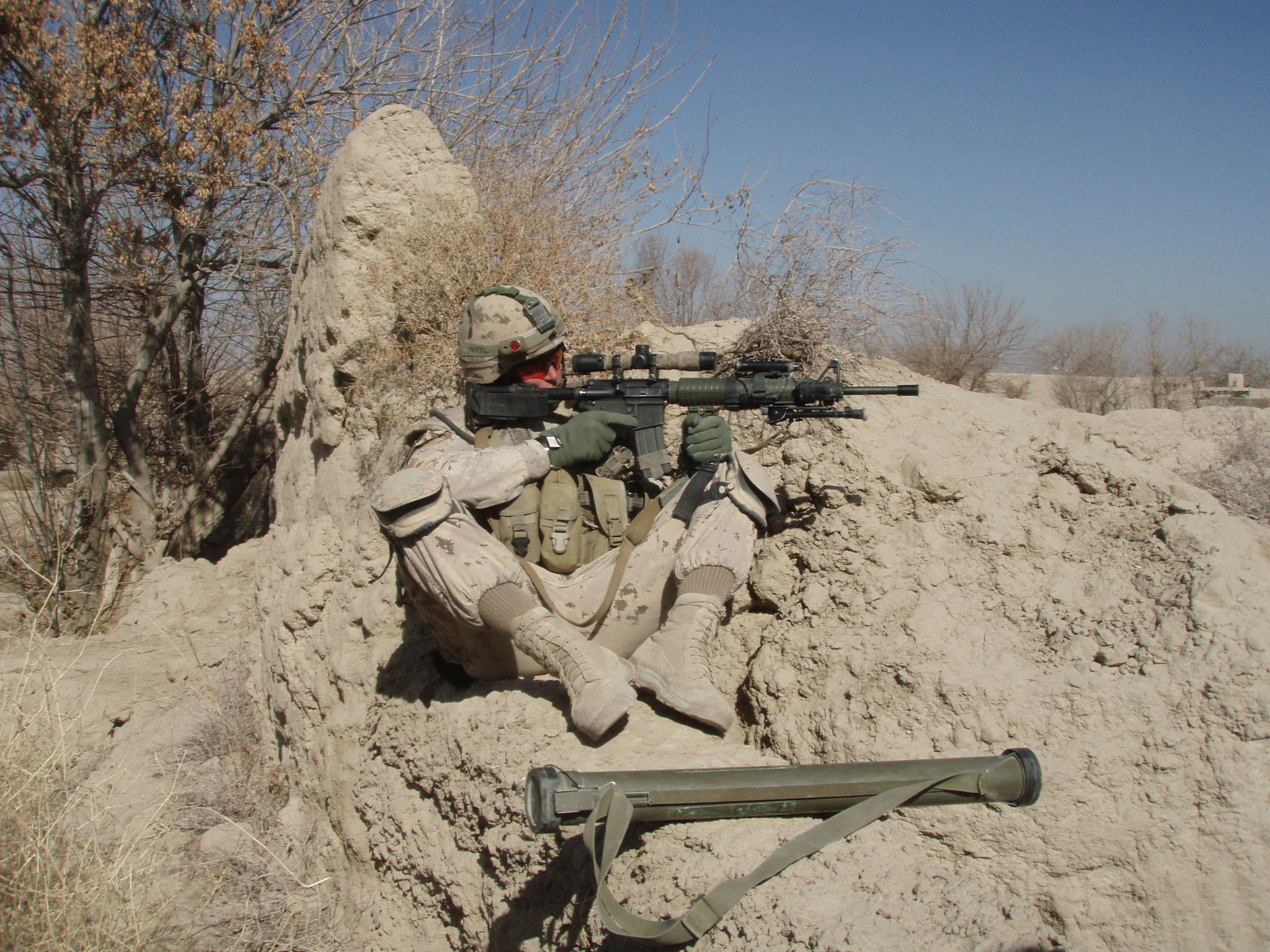 Corporal Muir pulling perimeter security around a shattered school that the Canadians were attempting to restore, outside Forward Operating Base Sper Wan Ghar, Panjwaii district, Kandahar, approx. Feb.-March 2010.