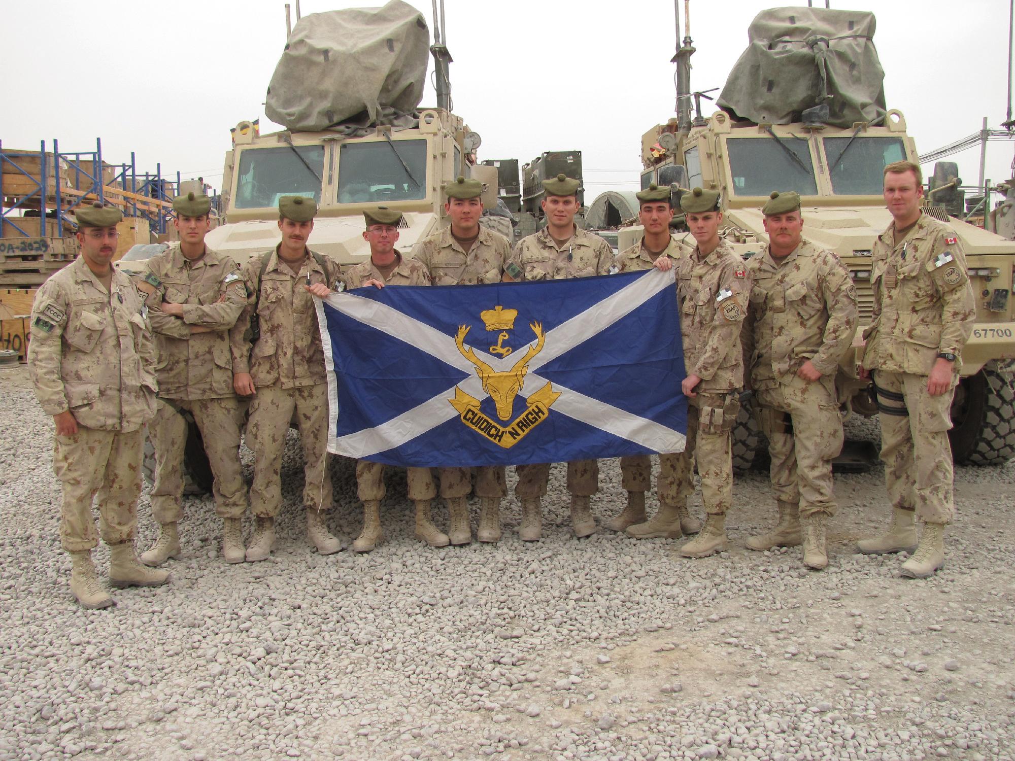 Kandahar Airfield, March 2010: Some of the Seaforth Highlanders who were members of the Convoy Escort Platoon. L-R, Corporals Mike Almeida, Matt Swanston, Bryden Telford, Brett Tyre, Mackenzie Robinson, Grant Belich, Ben Chau, Kyle Yorston, Trevor Street, Captain Jason MacEwan.