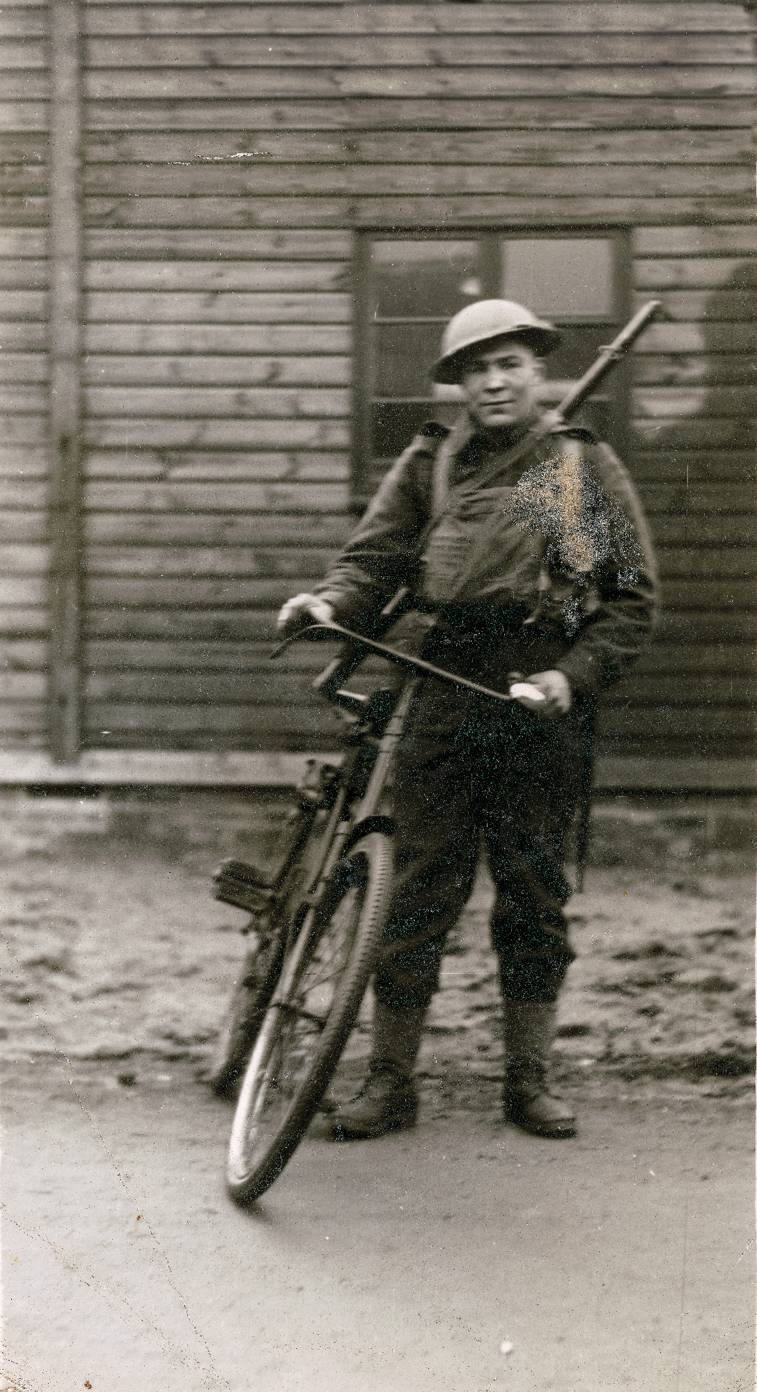 Private Harold Hammond | In an age without personal radios, he has been tasked as a runner to carry messages and orders, and he has been issued a bicycle to make him more efficient.