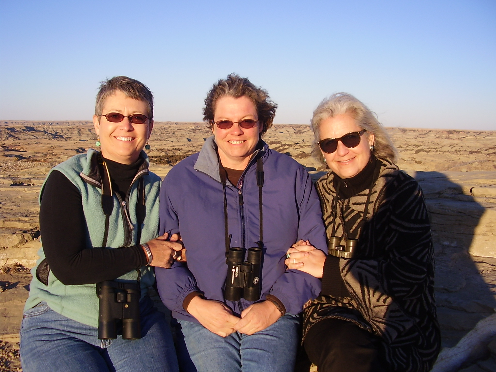 From left to right: Lillian Crook, Valerie Naylor, and Terry Tempest Williams at Painted Canyon, TRNP. March 9, 2008. Photo by Jan Swenson.