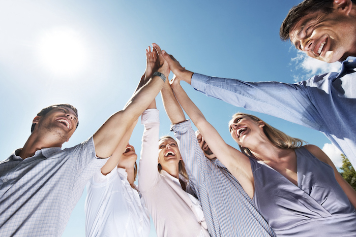 Close-knit circle of friends without sweat patches — as imagined by a stock photographer with no friends