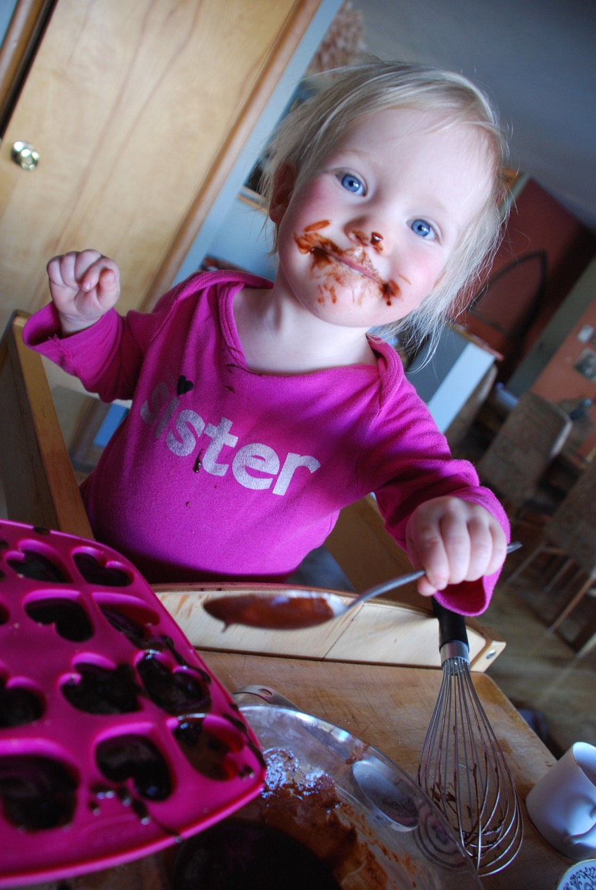 HELPERS: SADIE SPOONS ON CHOCOLATE SAUCE AFTER LICKING THE WHISK.