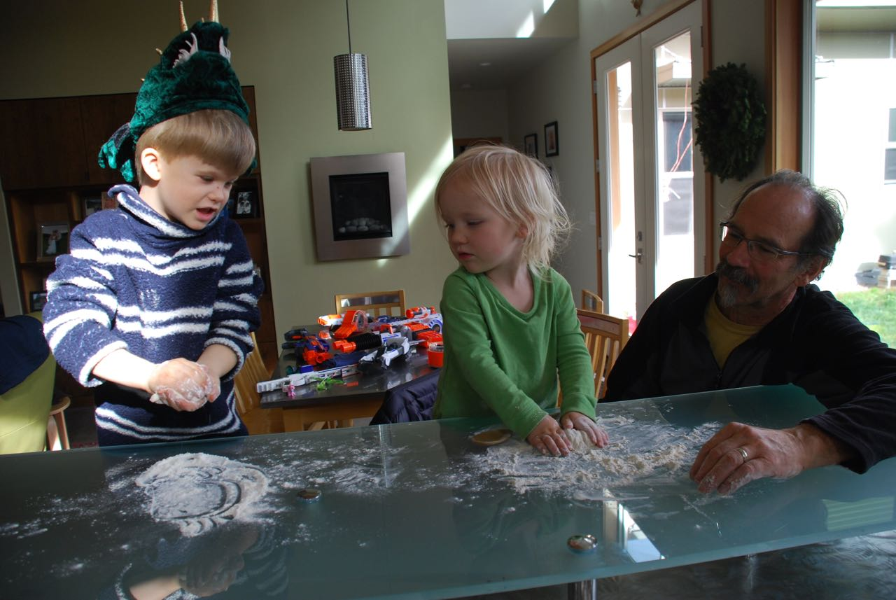 You can see the arsenal of nerf guns behind as the younger cousins help make rolls.