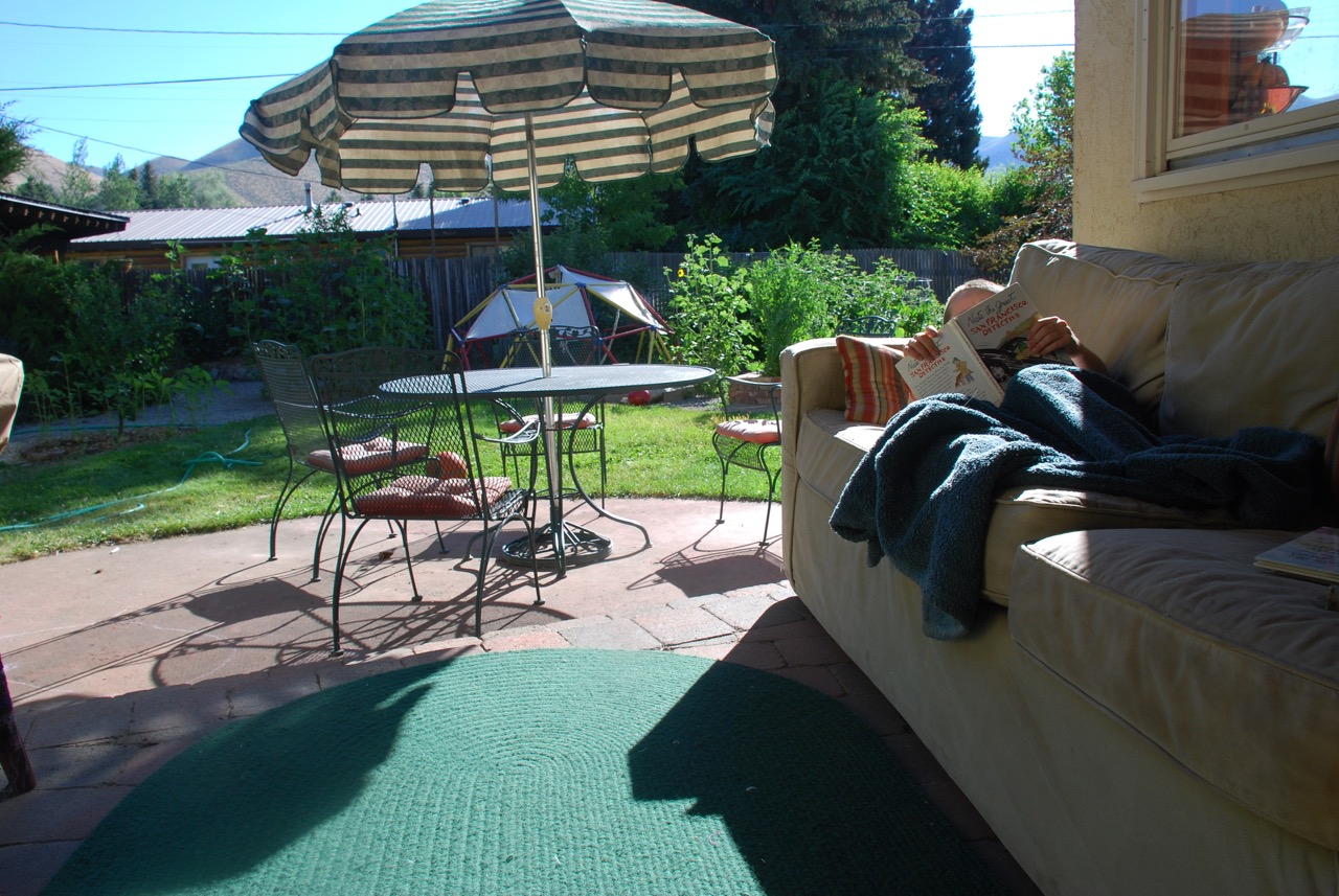 The quintessential summer day, relaxing with a good book in our newly formed outdoor living space