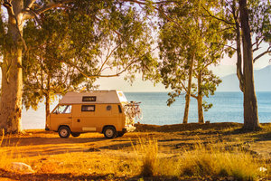 103055266 - tourism vacation and travel. camper van on beach seashore in greece