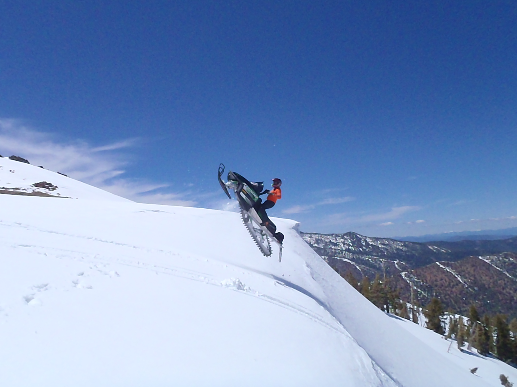 Steve, Chiropractor, Age 50,snowmobiling in Mt. Shasta, CA.