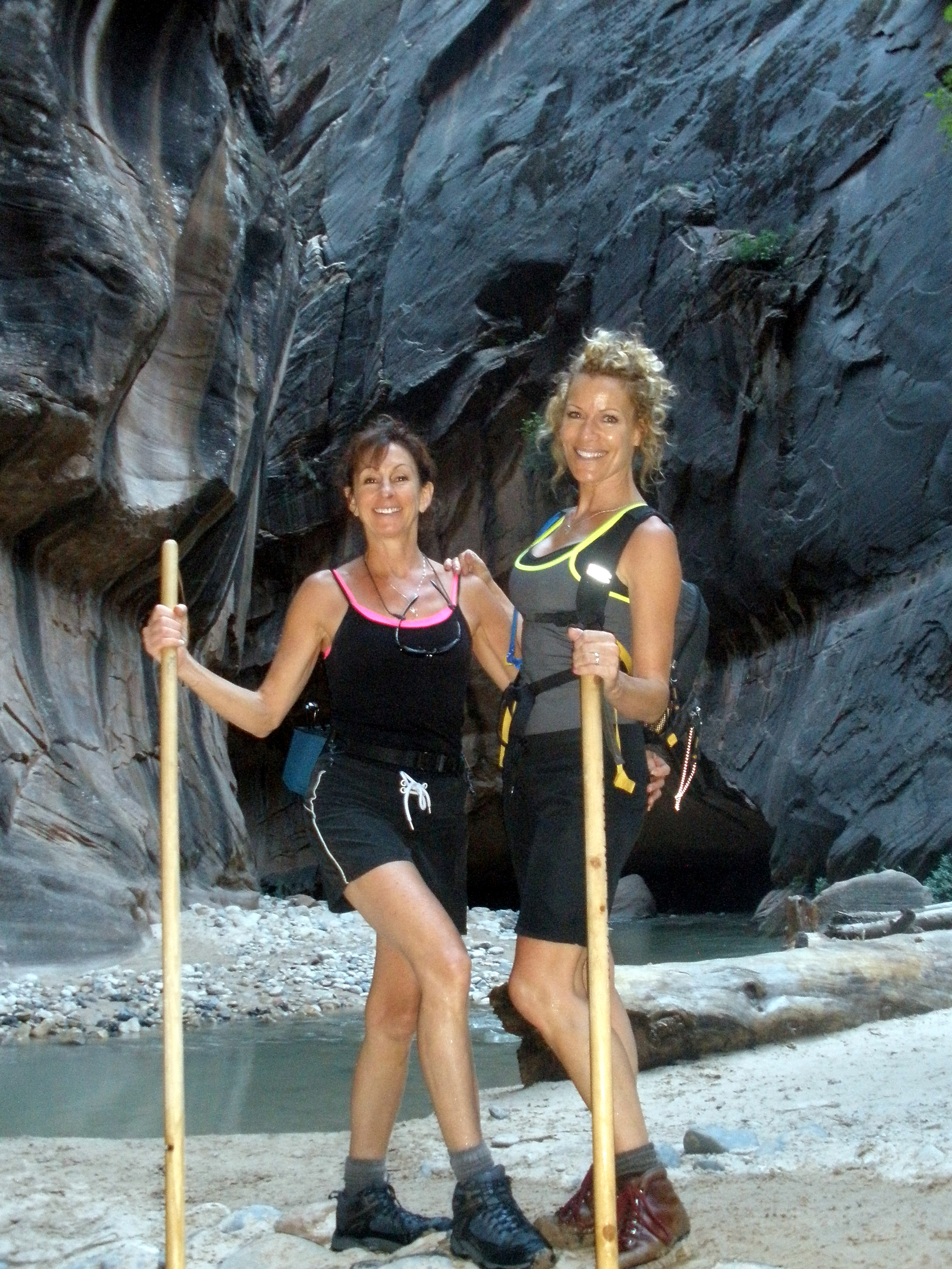 Vicki Whaley, Health Insurance Agent, Age 53, and Jami Hanna, Age 53, hiking  The Narrows , Zion National Park, UT.