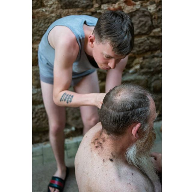 As usual Robbie takes his spontaneous hair cut in the alley way between the town church and home. . . . . . #girona #catalunya #guccislippers #guccislides #fatherandson
