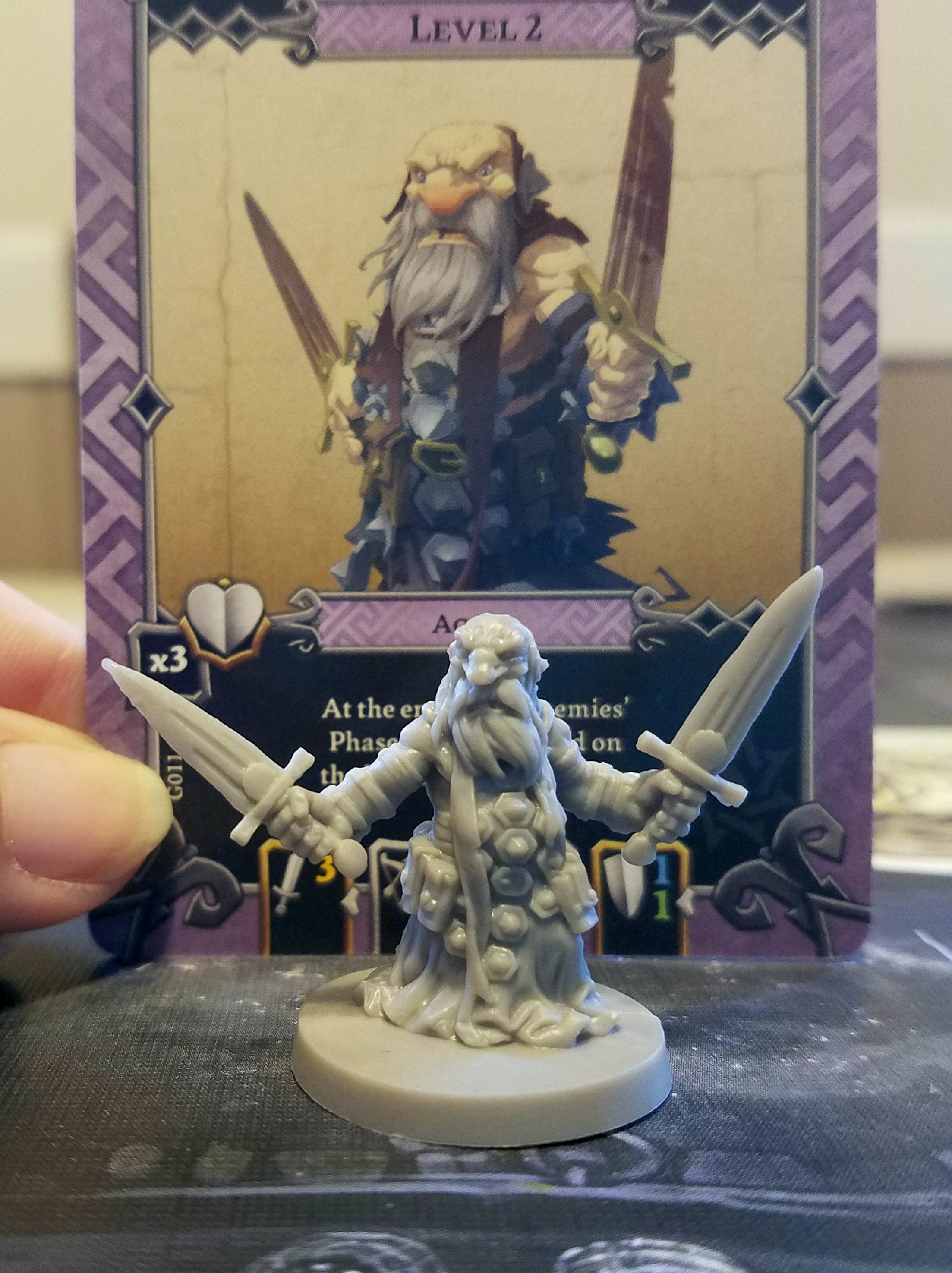 We had a little trouble matching monsters to their cards, mainly as the pictures on the card and the model aren't exactly the same. Having the same number on the card as is on the bottom of the mini would have been a real time saver for our first few games. (Also this guy is totally the worst example of my issue as he matches up pretty well to his card.)