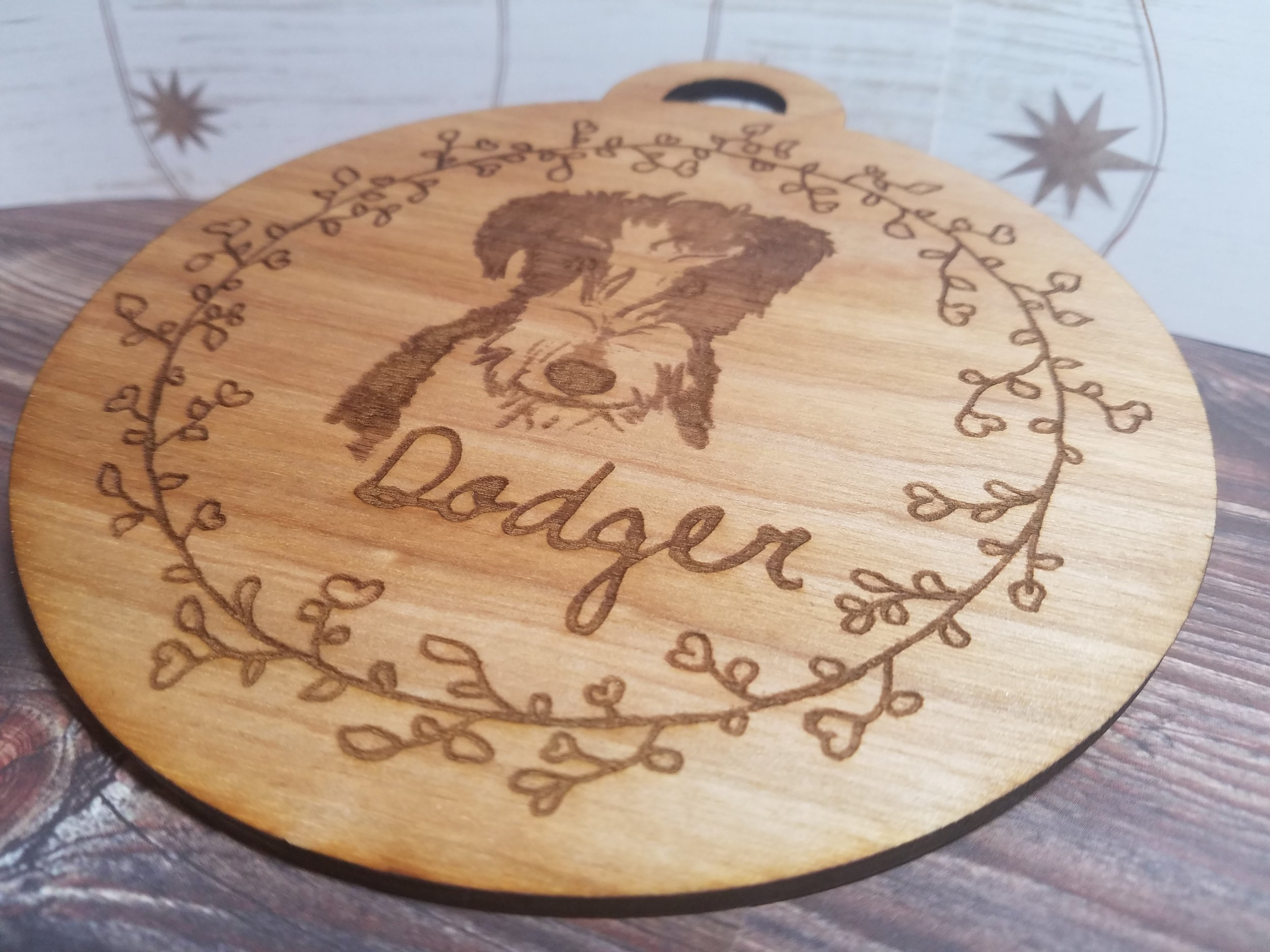 Hand drawn sketch Laser etched on a wooden ornament as a Memorial of the best dog ever.