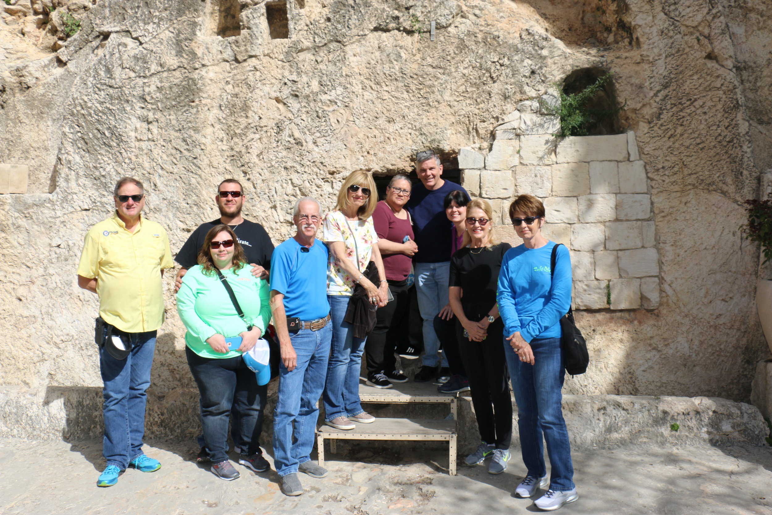 Some members of a retreat standing outside the empty tomb of Christ at The Garden Tomb