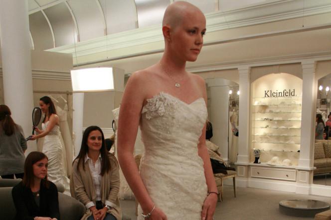 Margo Mallory (right) models a wedding dress. TLC