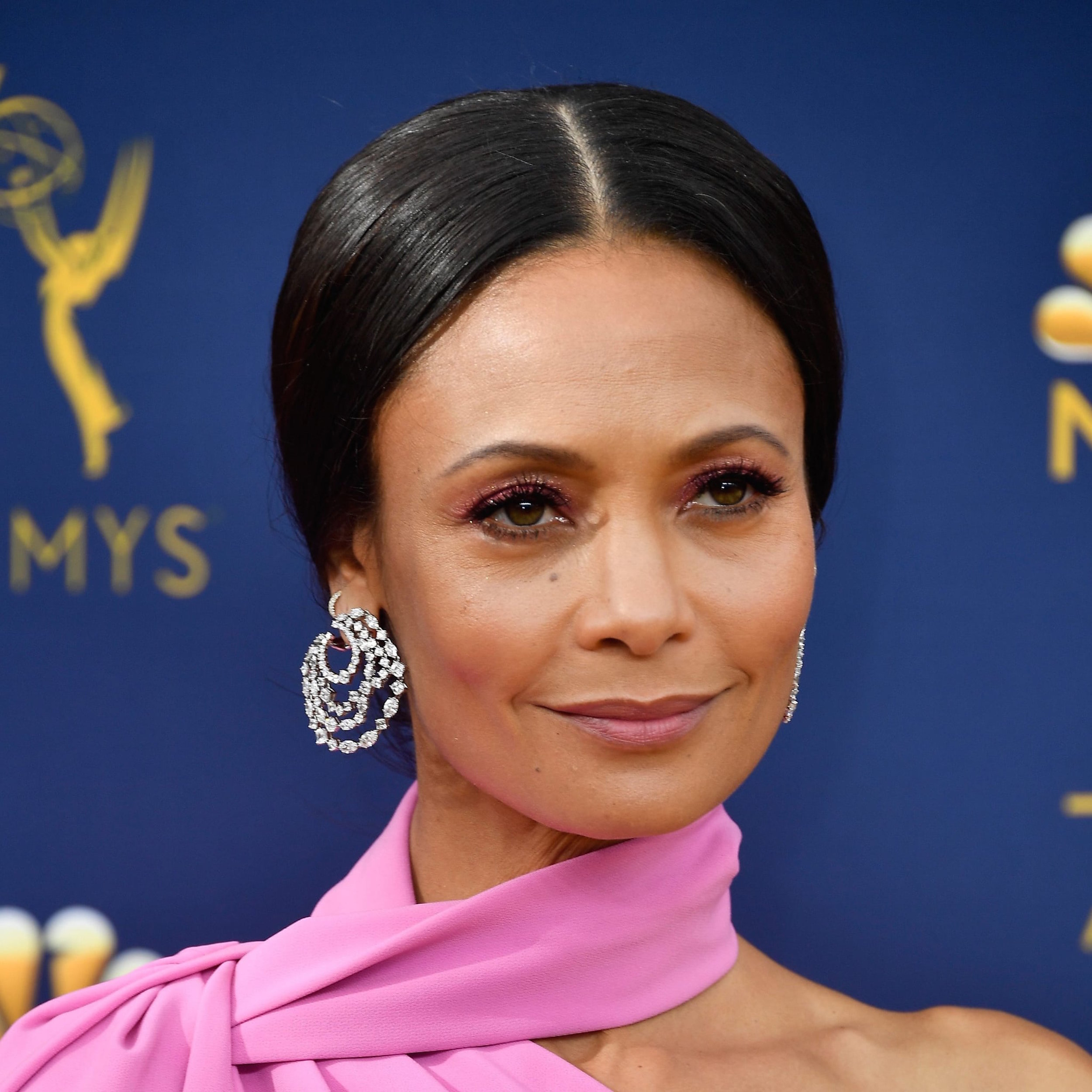 Thandie Newton, winner of the Outstanding Supporting Actress award for her role in HBO's Westworld, chose Harry Winston's secret combination diamond hoop earrings totaling 18.74 carats to accent her orchid-pink Brandon Maxwell gown. Her sleek, center-parted updo showed them off beautifully, and she finished her look with diamond and platinum bands, also by Harry Winston. -