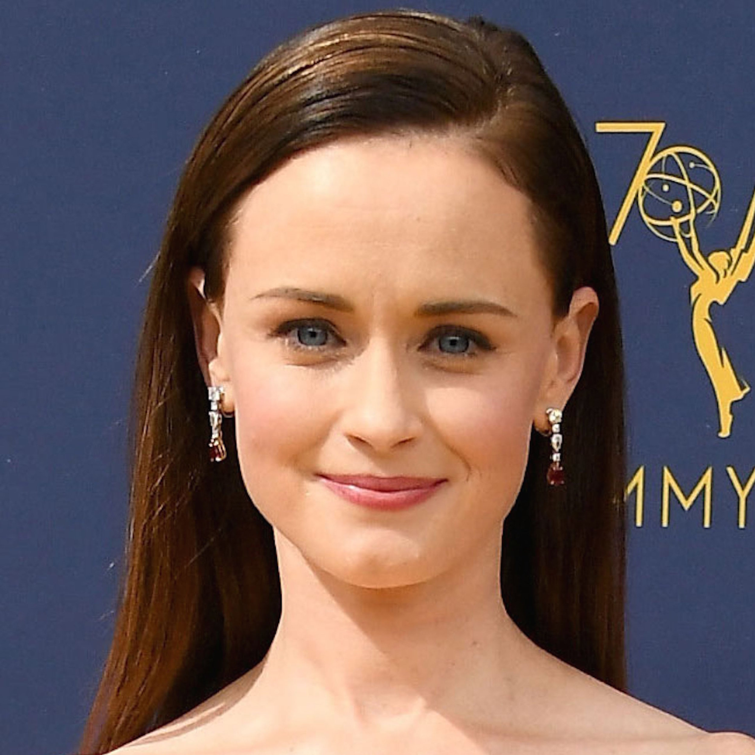 Plain diamond earrings would have done the trick when it came to Alexis Bledel, nominated for her role in Hulu's The Handmaid's Tale, but we love that she wore Harry Winston diamond earrings tipped in pear-shaped rubies with her multi-colored Delpozo gown. The red gems, possibly a subtle nod to Handmaid's signature color, picked up the garment's feathered appliqués. -