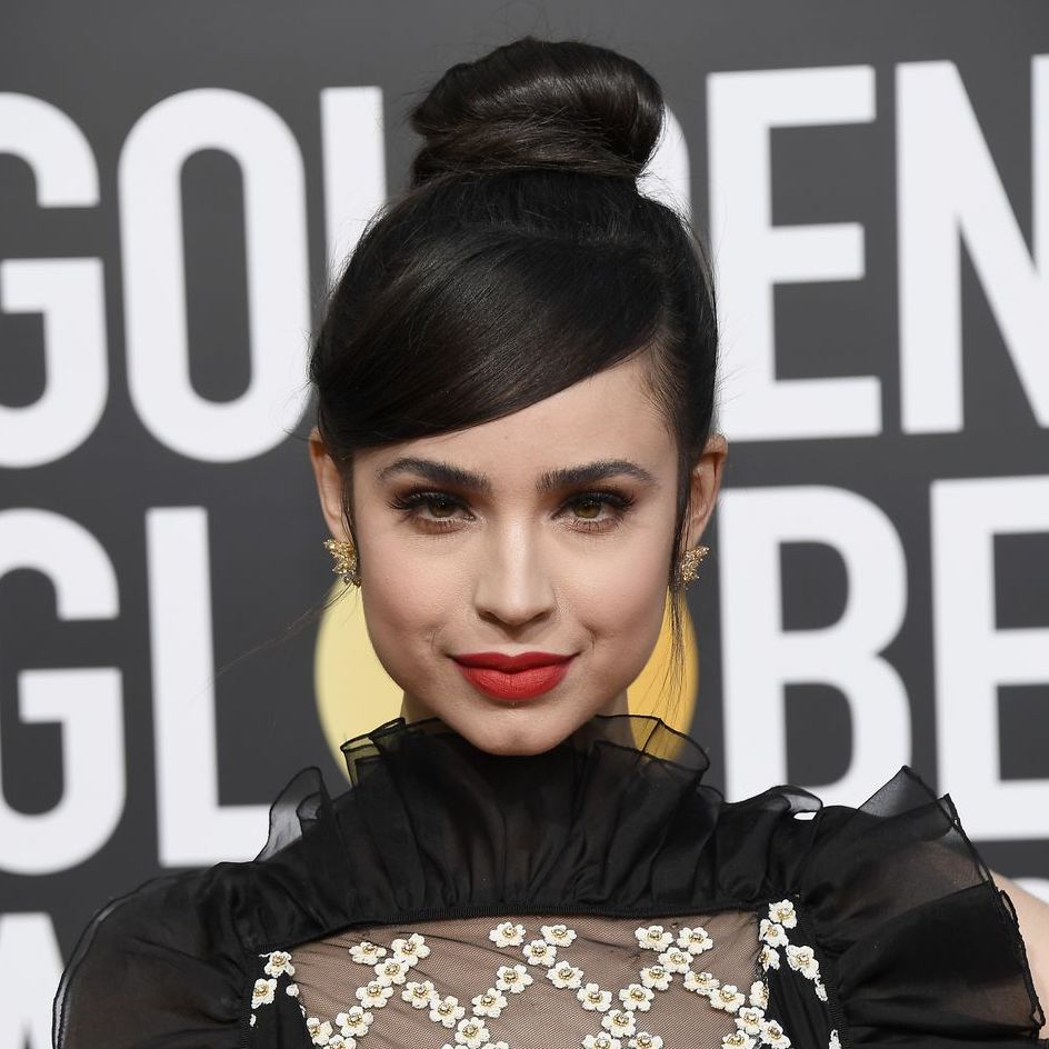 Sofia Carson: Top Knotch - Attention, brides around the world: the bar on topknots has been officially raised. Wait – was it actually a bun? A classic updo? A topknot-bun-updo mashup? Carson's hair look was so otherworldly that it almost deserves its own new name and category. We heart, big-time, that it was paired with swoopy, substantial bangs. Vive la difference, bébé.