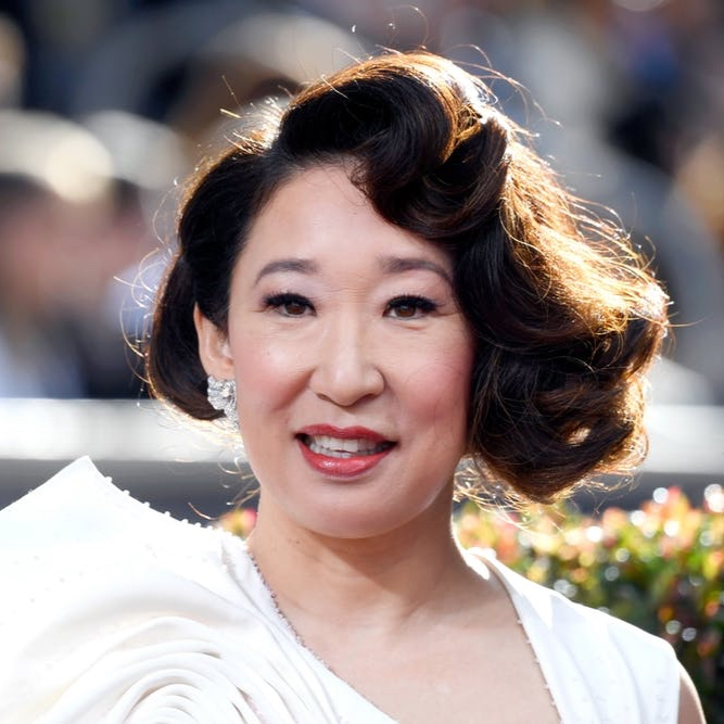 Sandra Oh: V for Versatility - Between the awards-hosting and the award-winning, It was Oh's night. But we'd also like to give a solid round of applause to Ted Gibson, her mane man. Gibson and crew switched it up, big-time, over the course of several hours, pinging back and forth between loose and free-flowing, scraped-back and a charming half-up scenario. Of course it doesn't hurt that Oh has naturally thick, luscious locks. Of course she does.