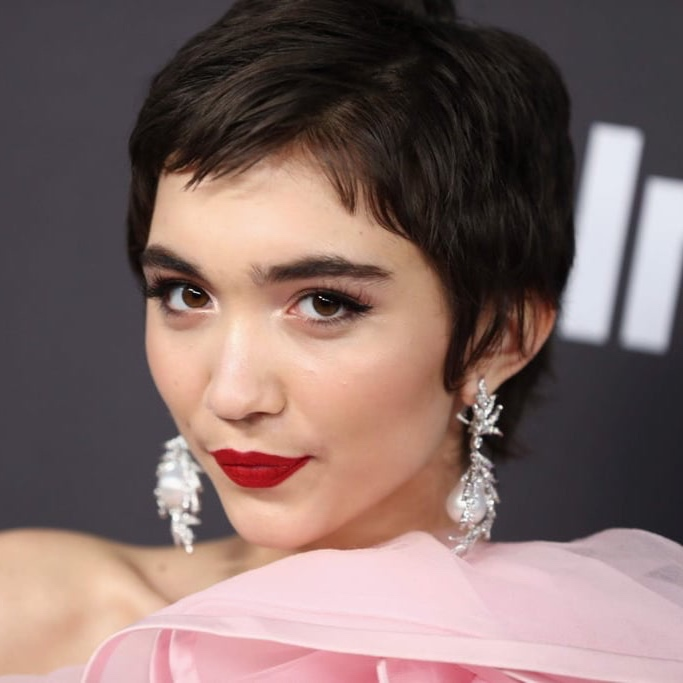 "Rowan Blanchard: Pixie Perfection - Channeling a posse of cropped- coif icons (Mia Farrow, Natalie Portman and Edie Sedgwick among them), hairstylist Laurie Heaps lopped nearly nine – nine! – inches off Blanchard's locks before styling with Ouai Matte Pomade, Chi Spray Wax and a ghd dryer . ""I didn't want to re-create past pixies,"" Heaps noted. ""The look needed to be bolder with more attitude, more edge."" Mission accomplished."
