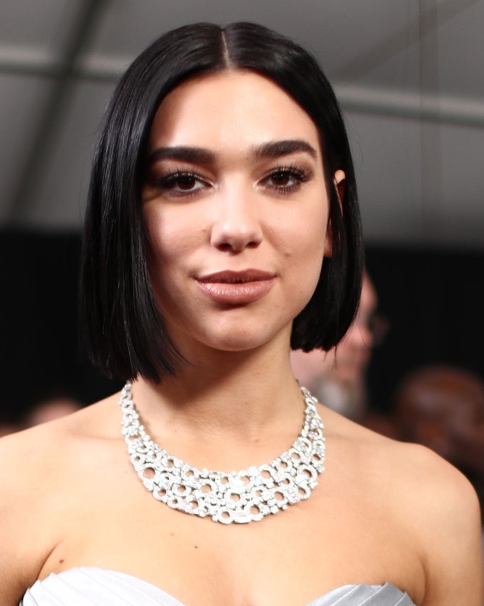 Dua Lipa: Blunt Beauty - Yes, the double winner (for Best New Artist and Best Dance Recording) got major kudos for her OTT silver and gold metallic mani, but we swooned over that sleek, center-parted bob. Her makeup, by Lilly Keys for Charlotte Tilbury Beauty, was equally girly. Think: multiple skin elixirs layered under dewy foundation, highlighted cheekbones, high-drama eyes and matte nude lips. Classy and pretty – a win-win.