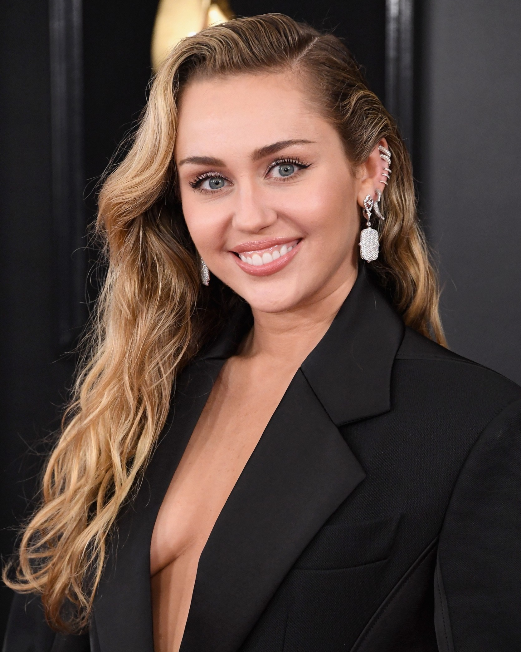 Miley Cyrus: Meet the Missus - Okay, maybe she was missing her shirt in her first outfit of the evening (an unspeakably cool Mugler suit featuring an oversized jacket and flared highwaters. Yes, yes and yes.). But ever since she got hitched to one of the Brothers Hemsworth, Cyrus has been presenting a fresh, feminine take on her frisky Southern self. Last night, we loved her long loose waves, low-key kitten liner and soft peach lip.