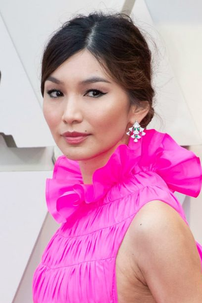 """Gemma Chan's Soft, Texture-y Touch - You just don't do stiff and lacquered with a dress that fabulously voluminous. """"The way Gemma combines extreme glamour and a certain coolness gives me French actress vibes,"""" says Clariss Rubenstein, celebrity hairstylist for The One by Frédéric Fekkai. """"I love how Brigitte Bardot's hair always looked intentional and had a point of view, while still looking totally effortless. I had that in mind when creating Gemma's look. I never want Gemma to look too coiffed. She's far too cool for that."""" Need we say more? Nope, that'll just about do it."""