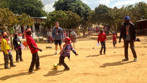 Brister and Sammy Joe playing soccer with the kids