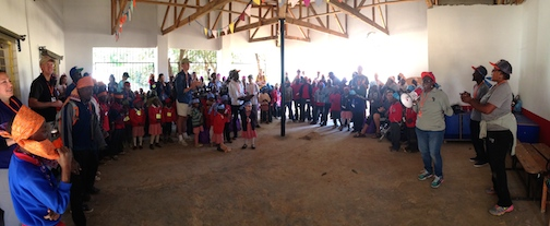 Brenda, Aqualine, and Joseph leading worship time with the kids