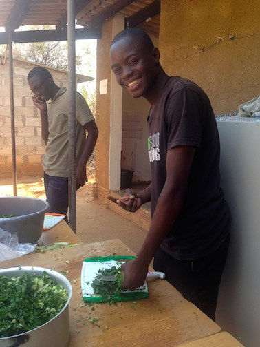 Jay cutting the vegetables for lunch