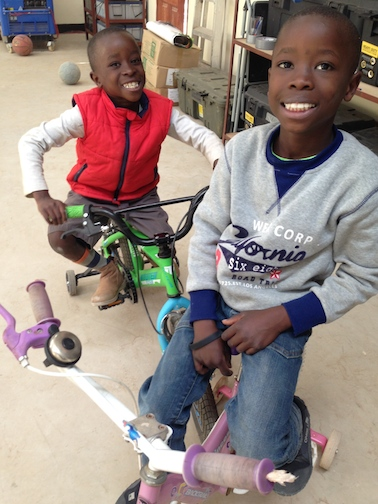 Lovemore (on the right) loves riding bikes