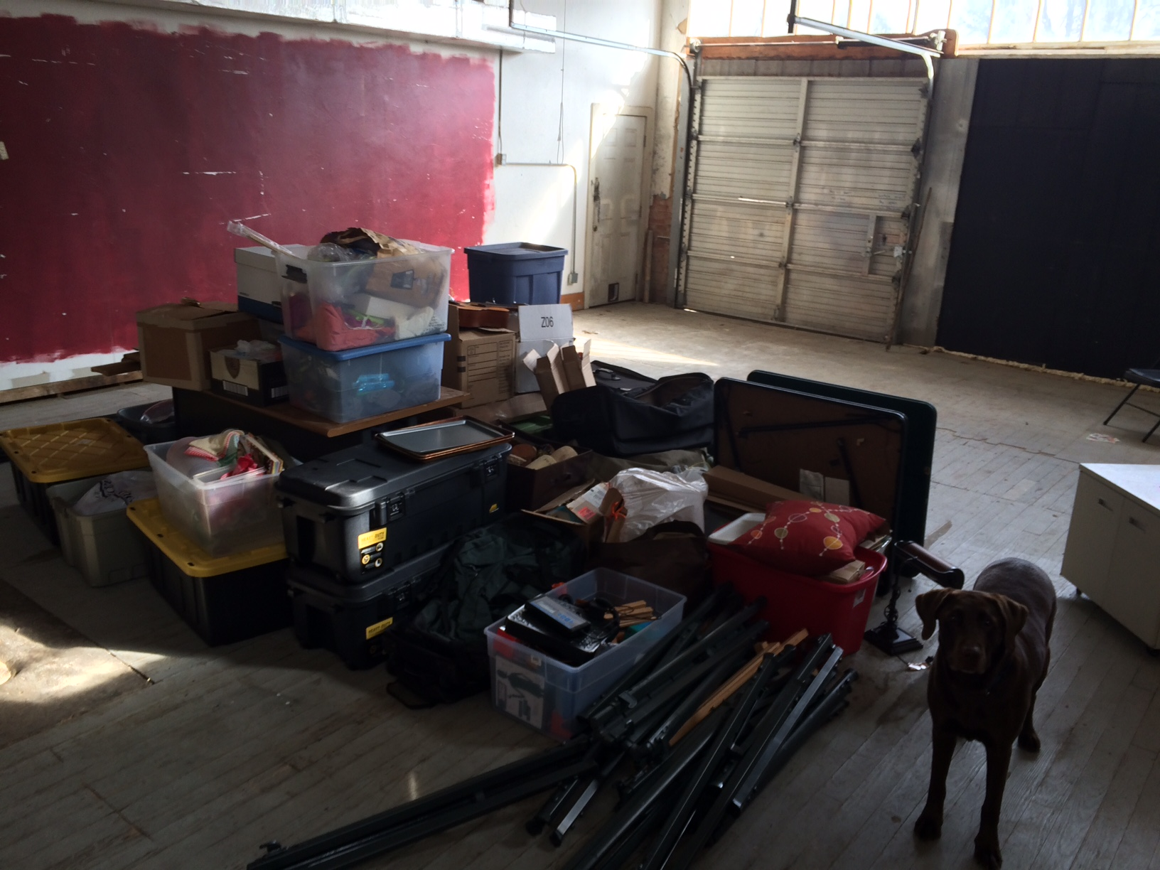 """Ella and some donations in the """"warehouse"""" section of the building."""