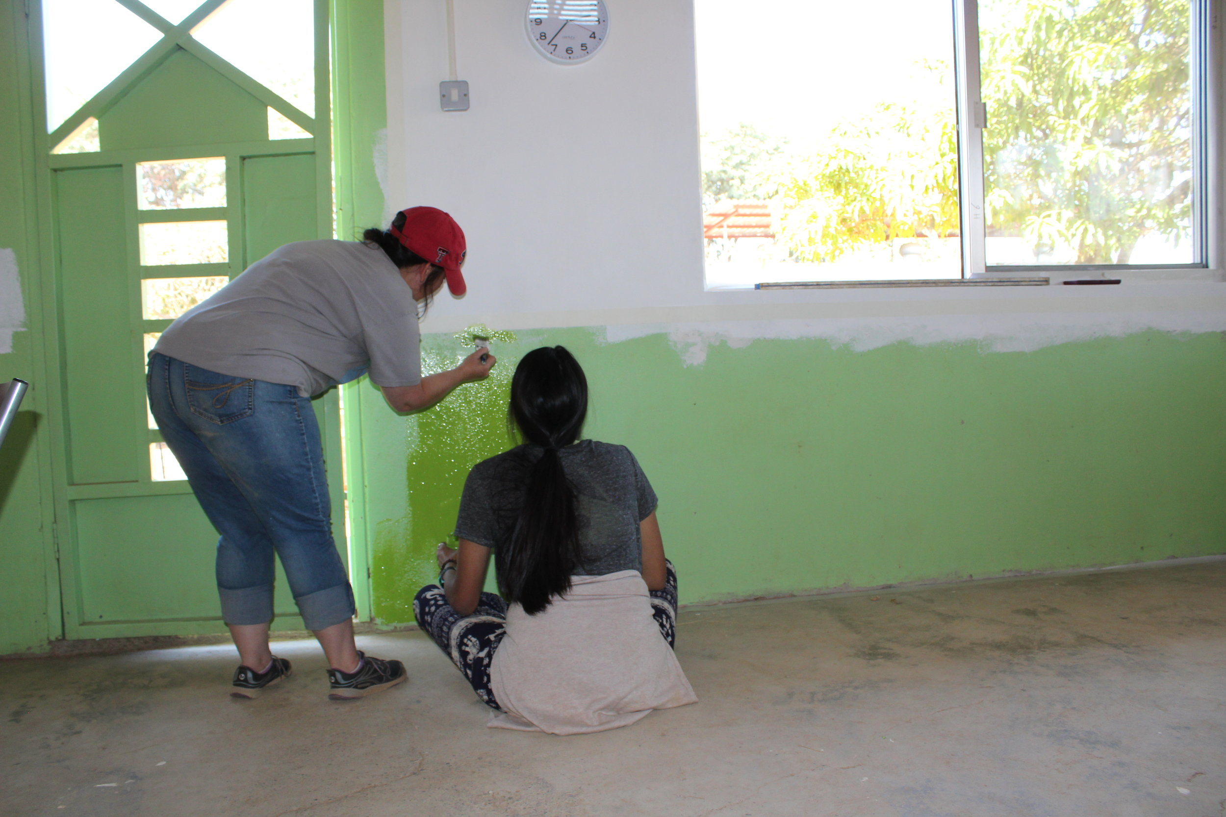 Andy and Jennifer paint the green room