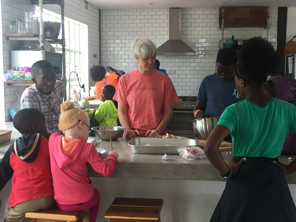 Erin helping the Arise Home children with cooking