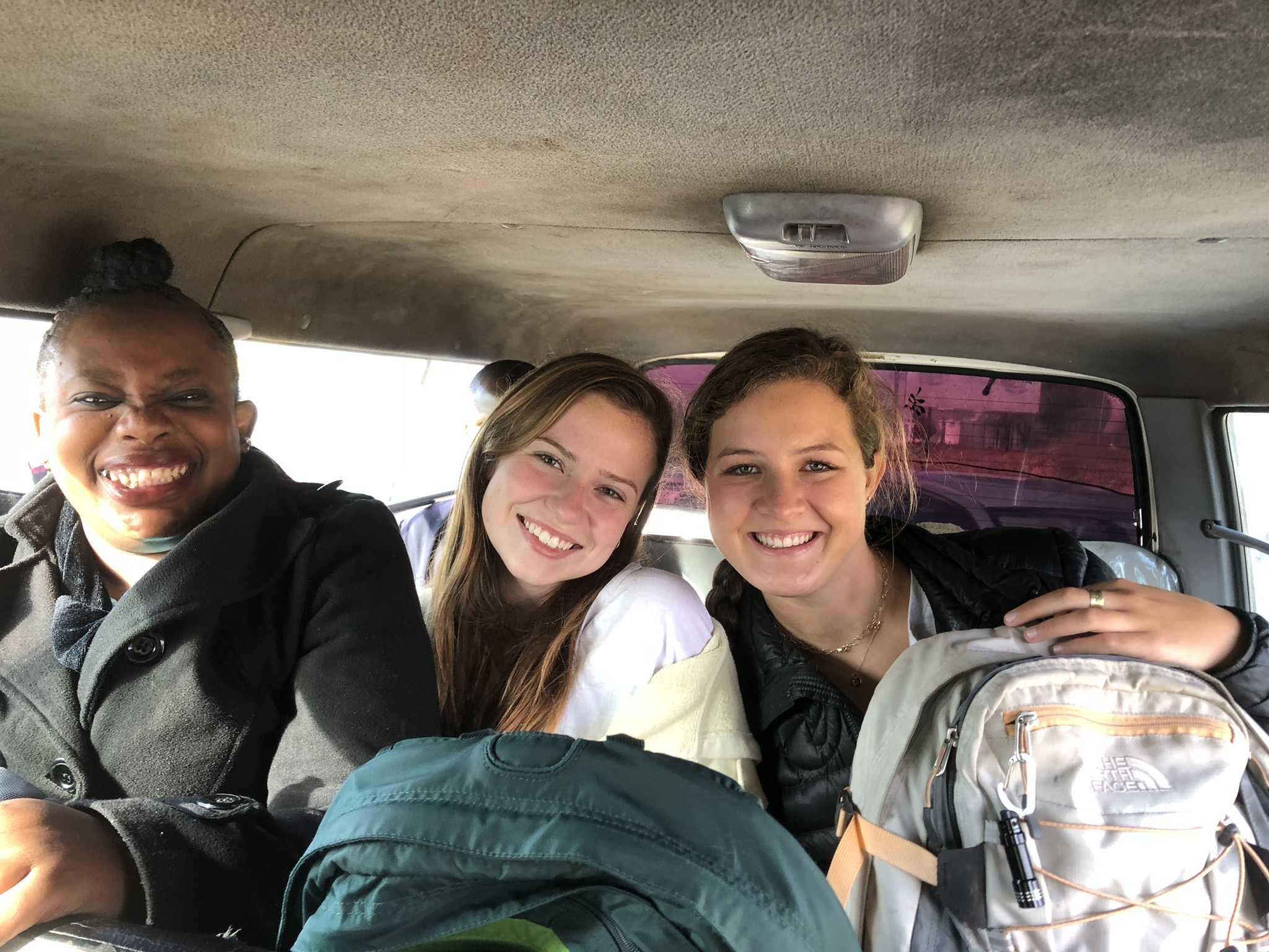 Lucy (CSO), Katherine, and Maryellen in a minibus on their way to Arise Christian School