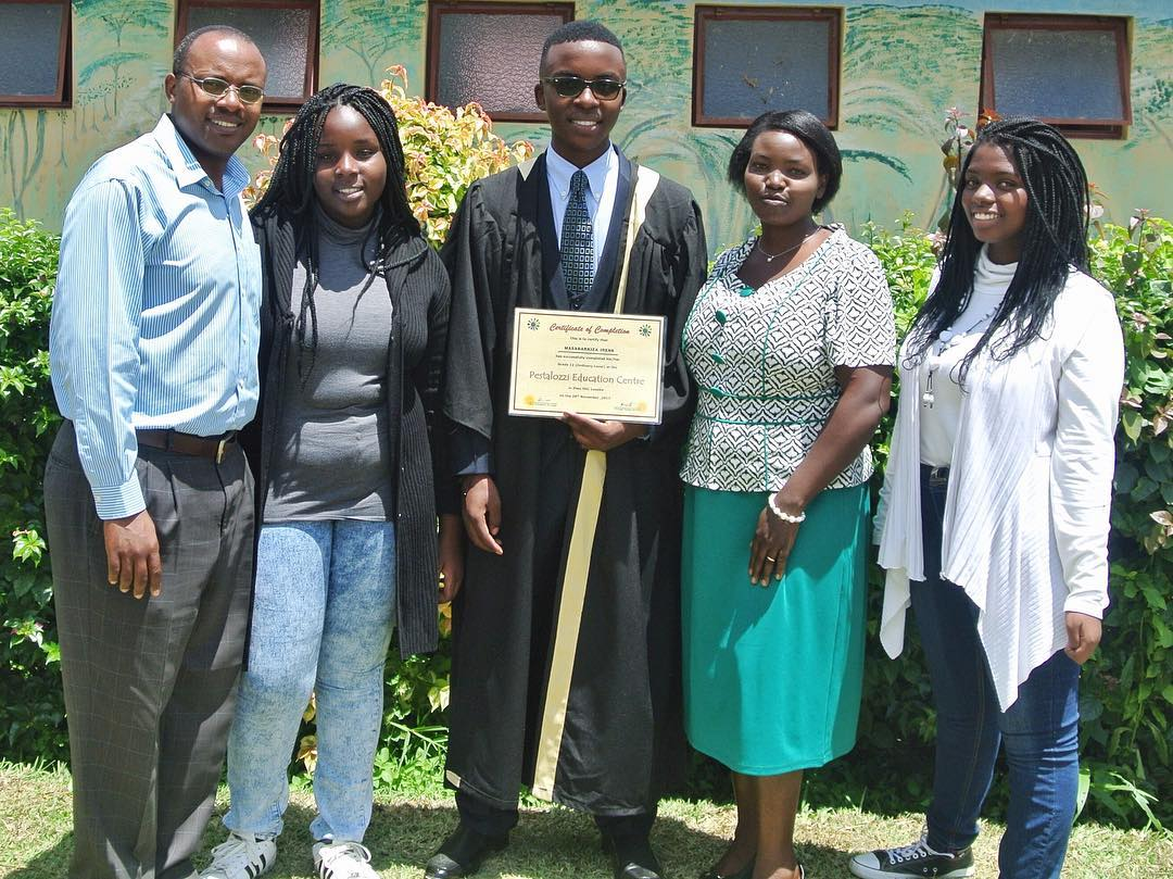 Irené and family at his 12th grade graduation