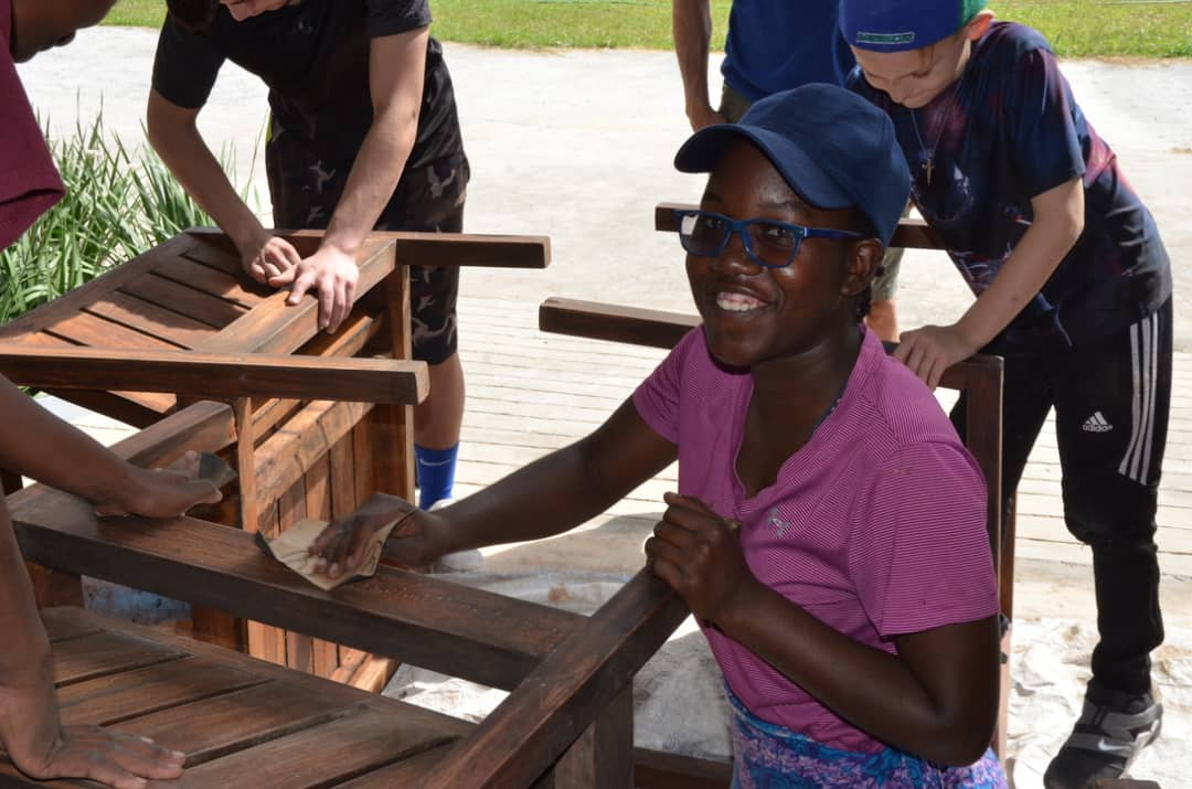 Margaret helping mission trip teams at the Complex