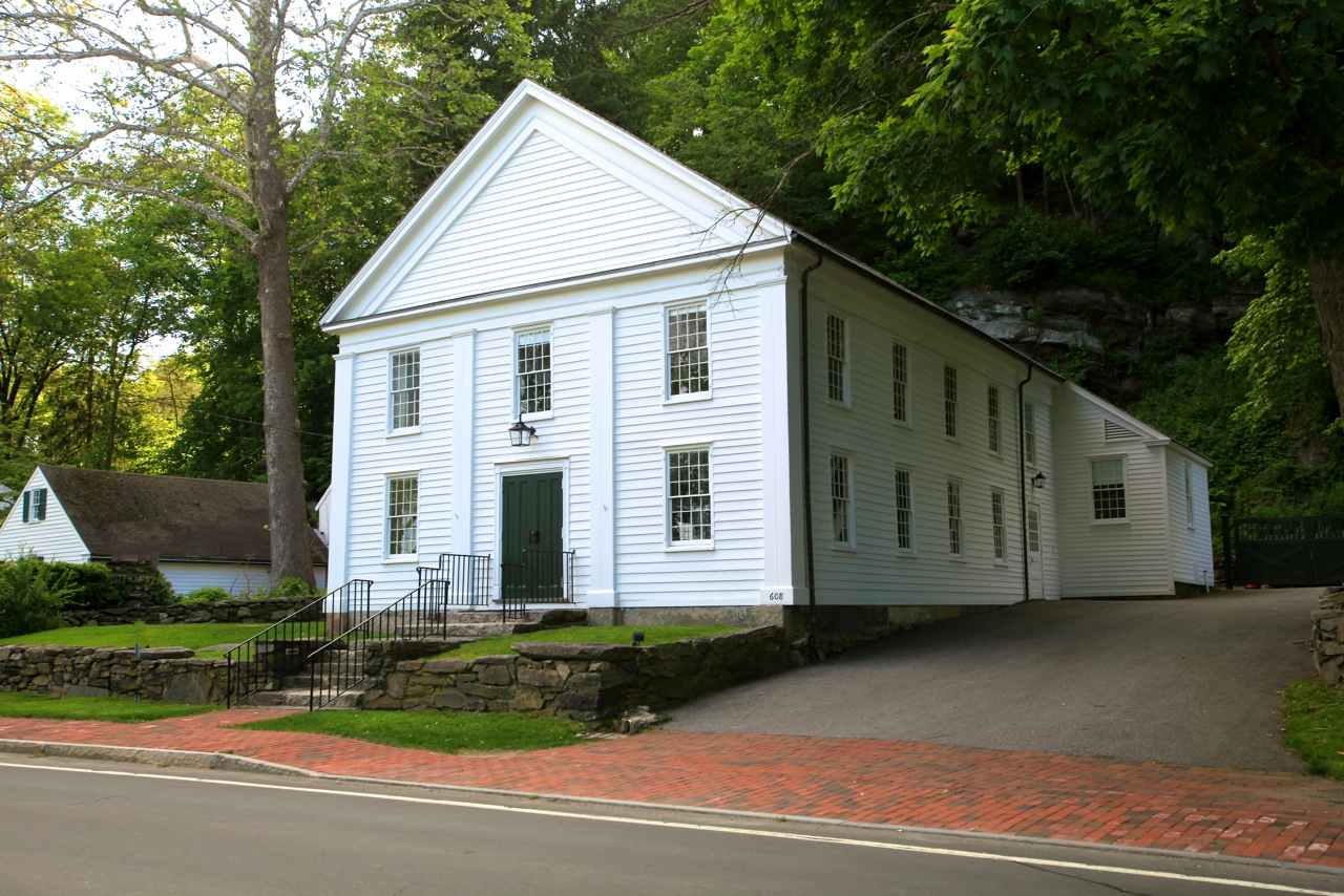 "Bedford's ""Historical Hall"" at 608 Old Post Road. Built in 1799, the building has been used in many different ways, and has been the site of our auctions since 1989."